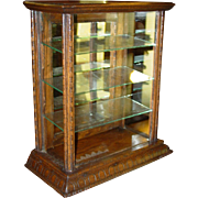 Neat small oak countertop gum display case