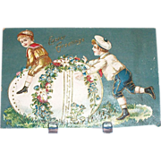 Easter Greetings: Boys Playing Leap Frog Over Egg Postcard