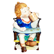 Hummel-Like Hand Painted Porcelain Toddler Girl In High Chair Figurine - Marked