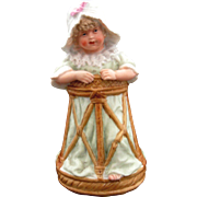Gebruder Heubach Baby in Walker Figurine