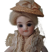 SOLD Darling 4 Inch All Bisque Mignonette with Long Braid & Great Little Pink Dress