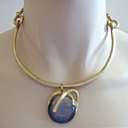Modern gold tone and striped art glass pendant necklace
