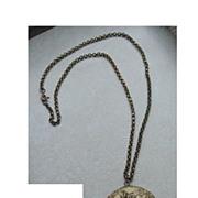 Art Nouveau iris double locket necklace in high relief