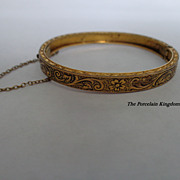 Antique brass hinged baby bracelet repousse floral and scrolls bangle