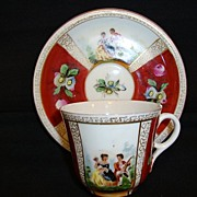 SALE Beautiful German Porcelain Cup and Saucer ~ Hand Painted Quatrefoil Panels of Courting Sc