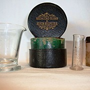 SALE Medicine Glass and Minim Measuring Cups / Beakers in Leather made by Maw Son & Thompson .