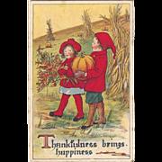 SOLD 1919 Thanksgiving Postcard Sweet Children Carry Pumpkin & Leaves