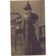 SOLD c1910 Real Photograph Postcard Handcolored Lady in Her Finery Reading Letter at Dressing