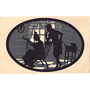 Rare C1910 Cut Paper Silhouette Hold to the Light Postcard, Lady Plays Lute? Gentleman watches