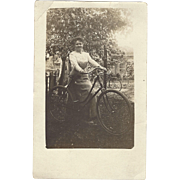 SOLD 1915 Real Photo Postcard, Lady With Bicycle, Bicycle in Background