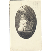 SOLD 1912 Real Photo Postcard, Child with Teddy Bear On Chair, Very Cute!