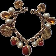 Accessocraft N.Y.C. 1960's Carnelian & Amber Glass Charm Bracelet