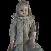 SALE PENDING Antique Wax over Papier Mache Child Doll in original Calico Dress