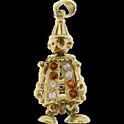 Vintage English 9 Karat Yellow Gold Gemstone Articulated Clown Pendant