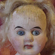 Early Bisque & Leather Doll