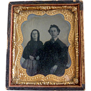 Antique daguerreotype girl and man portrait c. 1850s