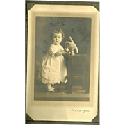 Charming Little Girl Curly Hair Stuffed Pussy Cat Toy Cabinet Photograph