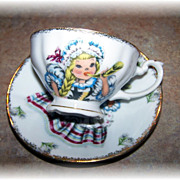 SOLD Hand Decorated Doll of Switzerland Tea Cup & Saucer