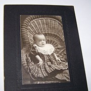 Victorian Era B&W Photograph Infant in Wicker Chair Wearing Bracelet