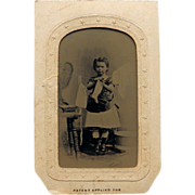 Girl Using Clothes Line Tintype In Paper Frame
