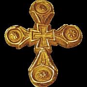 Striking Gold Tone Metal Cross Pendant