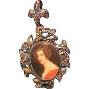 Vintage  Strongwater portrait pin on black velvet  ribbon