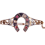 Antique Victorian Ruby and Diamond Horseshoe Bangle Bracelet in 18k Gold