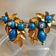 Vintage Teal Blue Rhinestone Earrings. AB Rhinestones. Gold Leaves.
