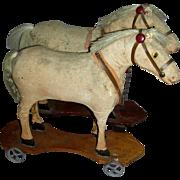 Team of 2 Velveteen Covered Horses on Wheeled Platforms, c. 1890-1900
