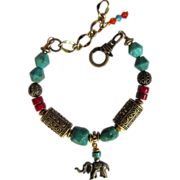 SOLD Turquoise and Brass Bracelet with Elephant Charm and Red Accents
