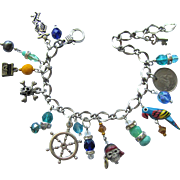 Pirate Charm Bracelet with Symbols of the Life of a Pirate including a Parrot