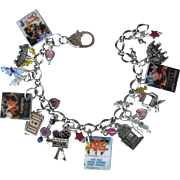 SOLD Classic Movies Charm Bracelet with Movie Charms - Tiny Movie Posters – Swarovski Crysta