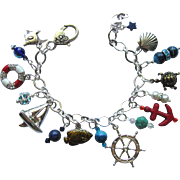 SOLD Nautical Theme Charm Bracelet with Sailboat – Life Ring – Sea Turtle - Anchor – Fis