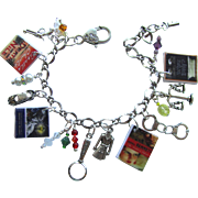 Mystery Lovers Charm Bracelet with Tiny Books – Trench Coat – Hand Cuffs – Magnifying ..