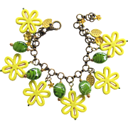 Charm Bracelet with Stylized Yellow Daisies and Green Lampwork Beads