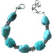 Bracelet of Natural Turquoise Nuggets and Carved Stone with Sterling Silver Accents