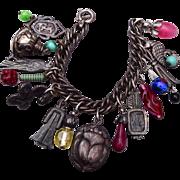 SALE Napier Egyptian Silver Tone and Glass Charm Bracelet