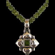 Green peridot necklace heart shield silver pendant romantic contemporary upscale jewelry