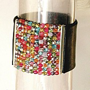 Leather jewelry design. Upscale leather cuff with rainbow colors beads.