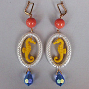 High end fashion jewelry design. Whimsical rubber earrings.